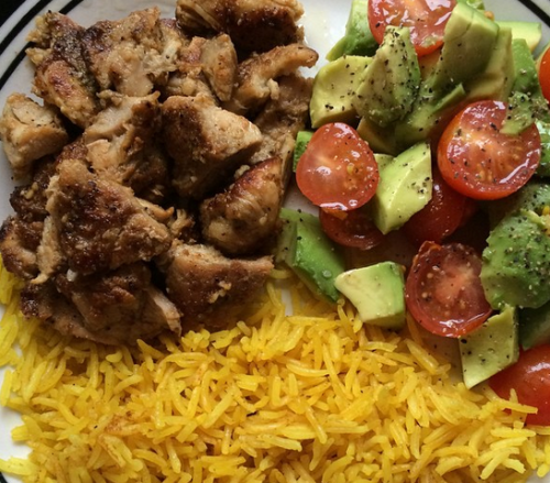 Lemon spice chicken with turmeric rice and a tomato/avocado salad